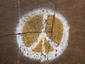 771168_peace_sign_painted_on_rock_1